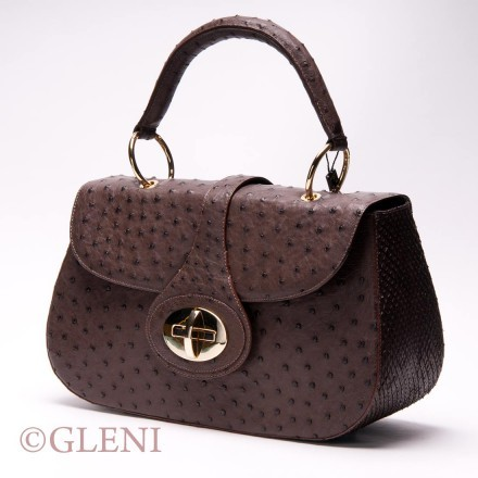 Very feminine ostrich and anaconda leather with golden details.